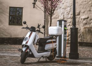 electric-scooter-charging-adapter-plug-no-emissions-opt-300x215-7136919